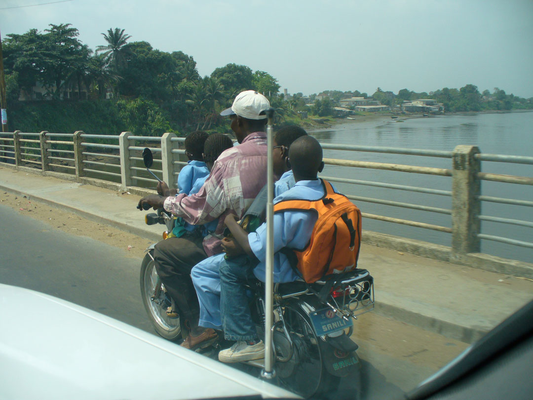 Father and 4 kids on motorcycle