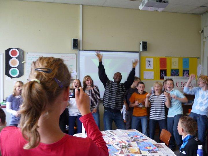 Angu Walters with children in Netherlands