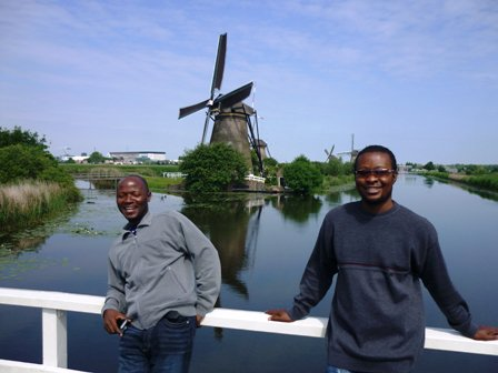 Angu Walters with windmill in Netherlands