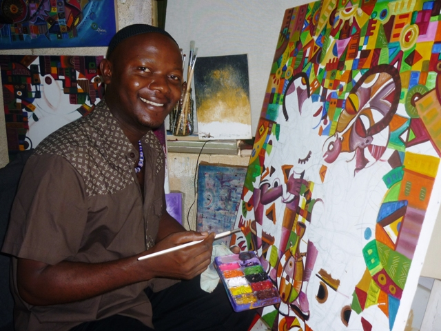 Angu Walters pauses from painitng