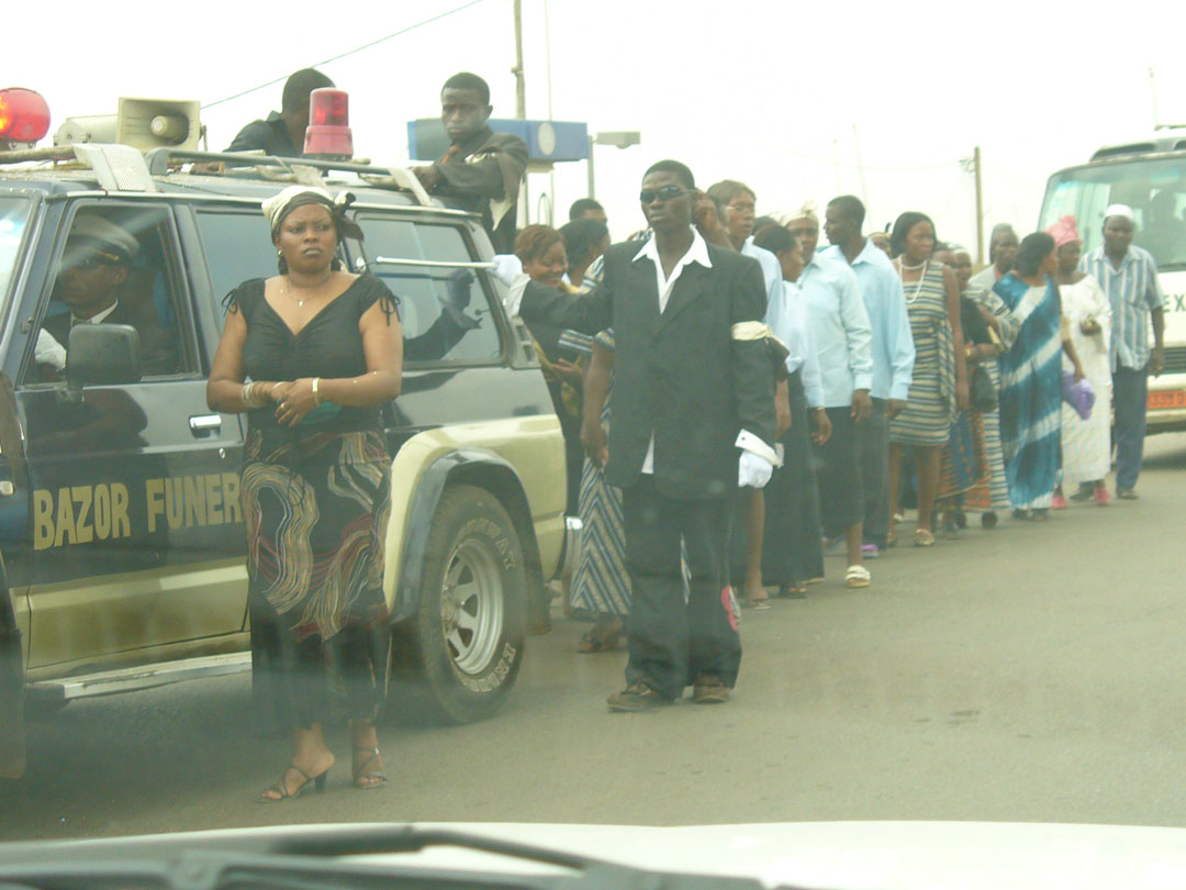 Solemn African funeral procession