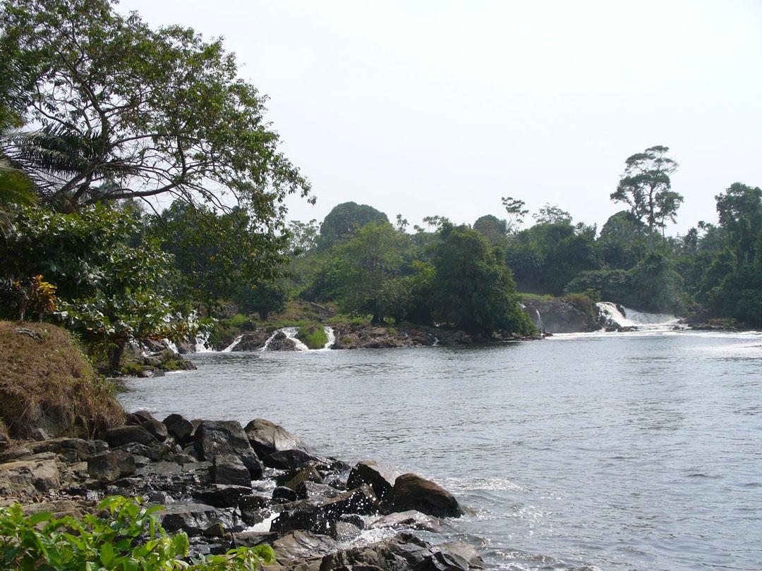Karibe African waterfall into ocean