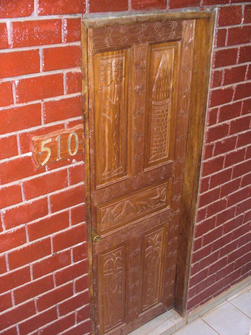 Carved hardwood door