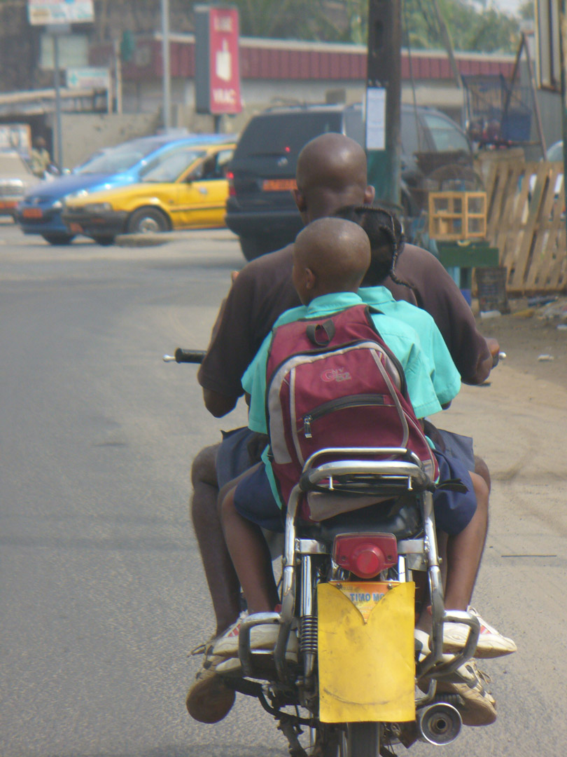 Father and 3 kids on motorcycle